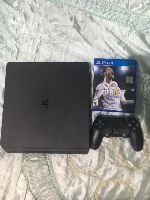 Fairly New PS4 Slim Console With Game CDs