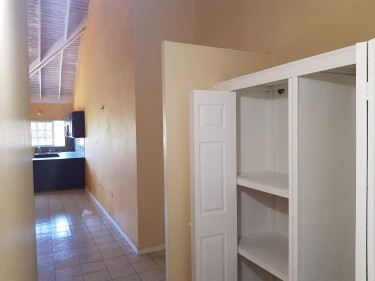 Spacious, 2 Bedroom (w/ A/C) 1 Bathroom For Rent.