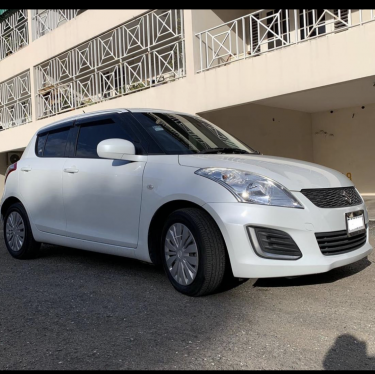 2015 White Suzuki Swift