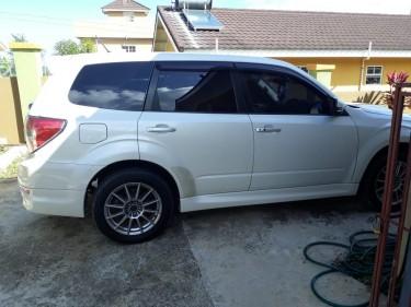 Pearl White Subaru Forester
