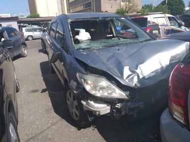 Damaged 2010 Mazda Premacy