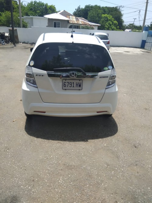 2013 White Honda Fit Hybrid Motor Car