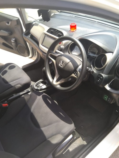 2013 White Honda Fit Hybrid Motor Car