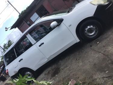 2011 White Mazda Familia