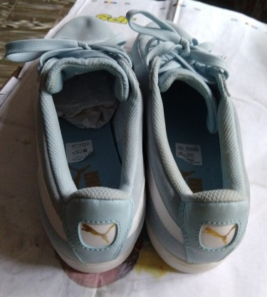 Blue And White Size 10 Puma Sneaker.