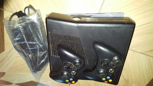 Xbox 360 With Adapter, 2 Controls, 1 Star Wars CD.