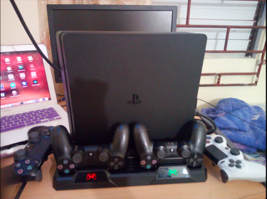 Like New PS4 Slim, 4 Controllers & Over 30 Games