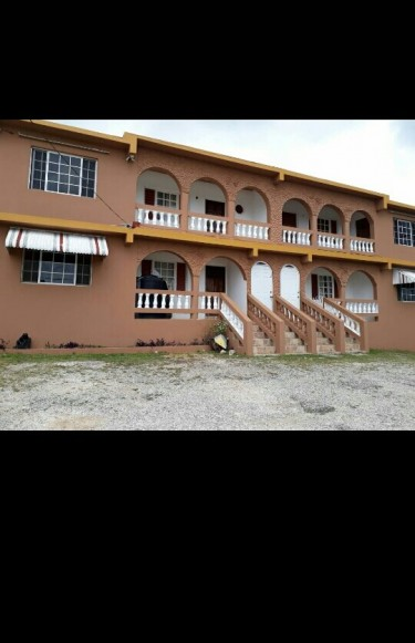 6 Self-contained Apts 10 Bedrooms 8 Baths Complex