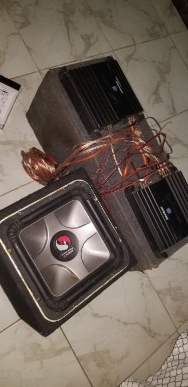 2 Alpine Sound Amps And 12 Inch Kicker