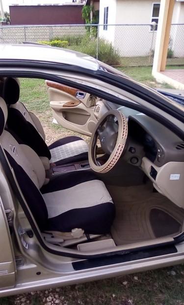 Brown Nissan Sunny