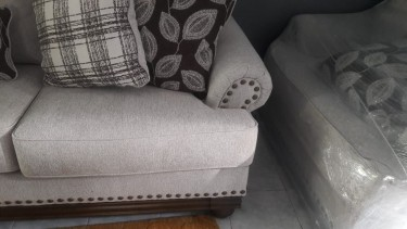 BRAND NEW ASHLEY LOVE SEAT