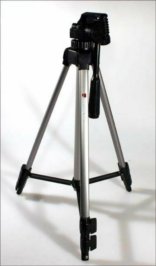 A Mini Projector And Tripod Stand